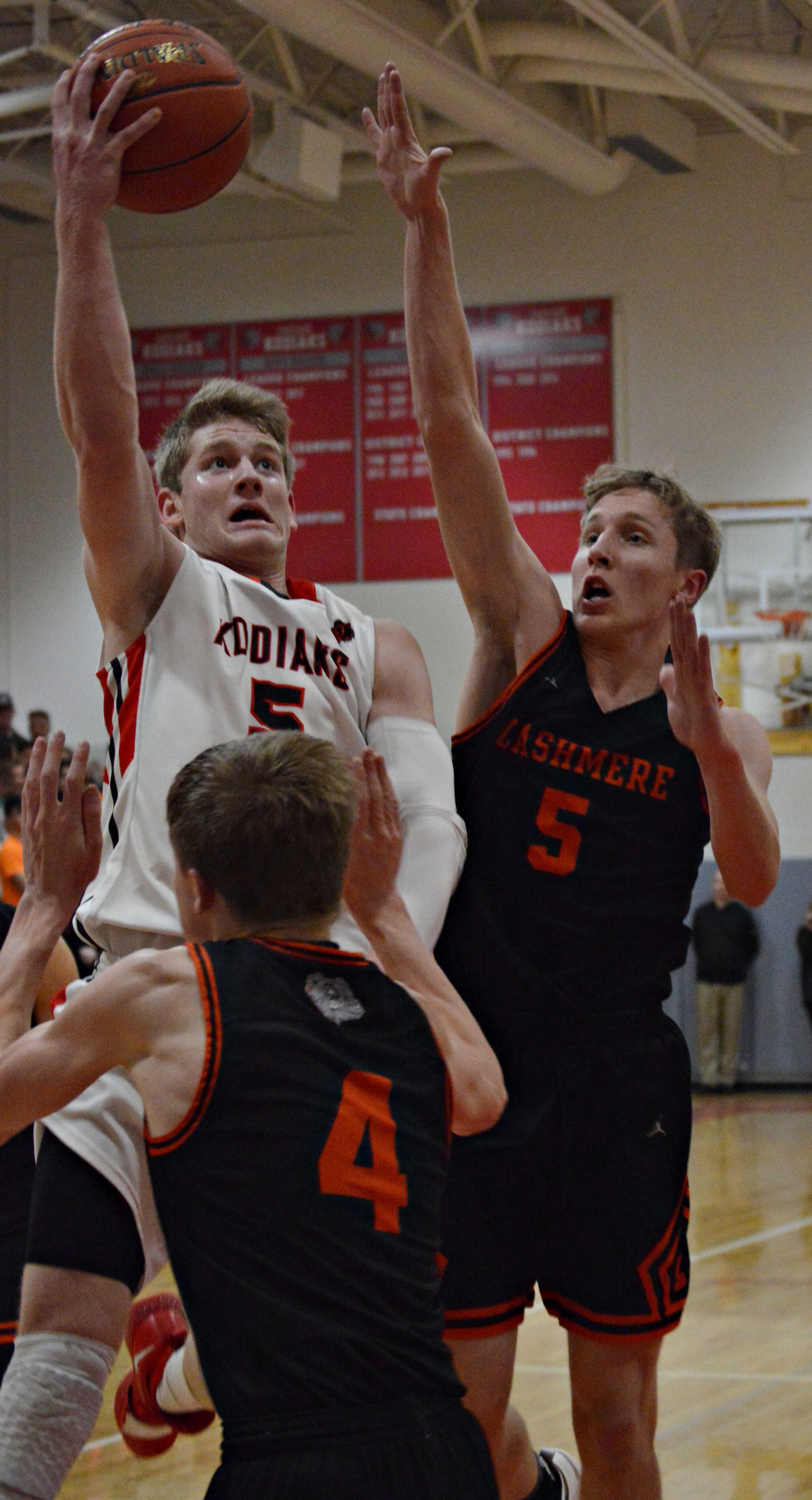 Cole Warnaca goes for two while covered by Cashmere defenders.