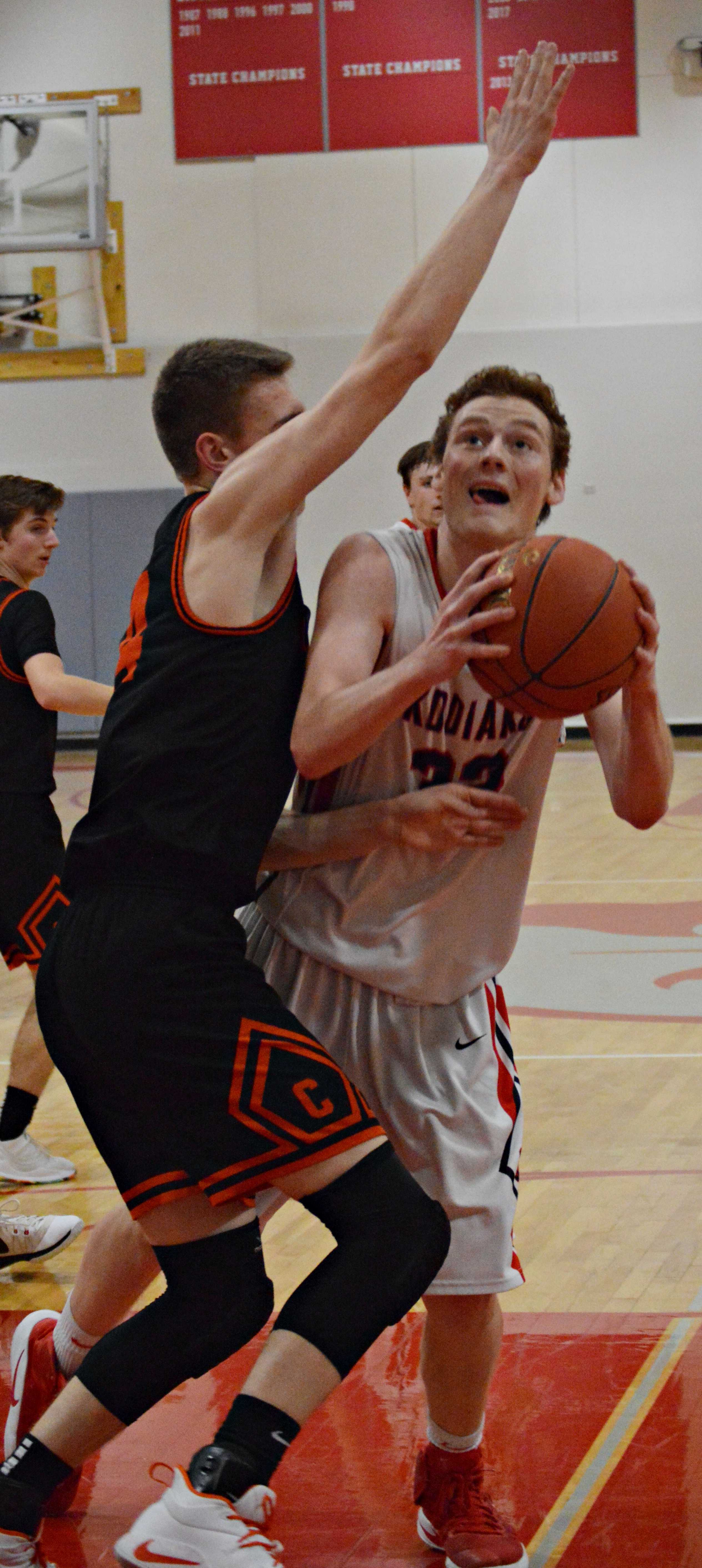 Hans Schlyer (right) led the Kodiaks with 24 points.