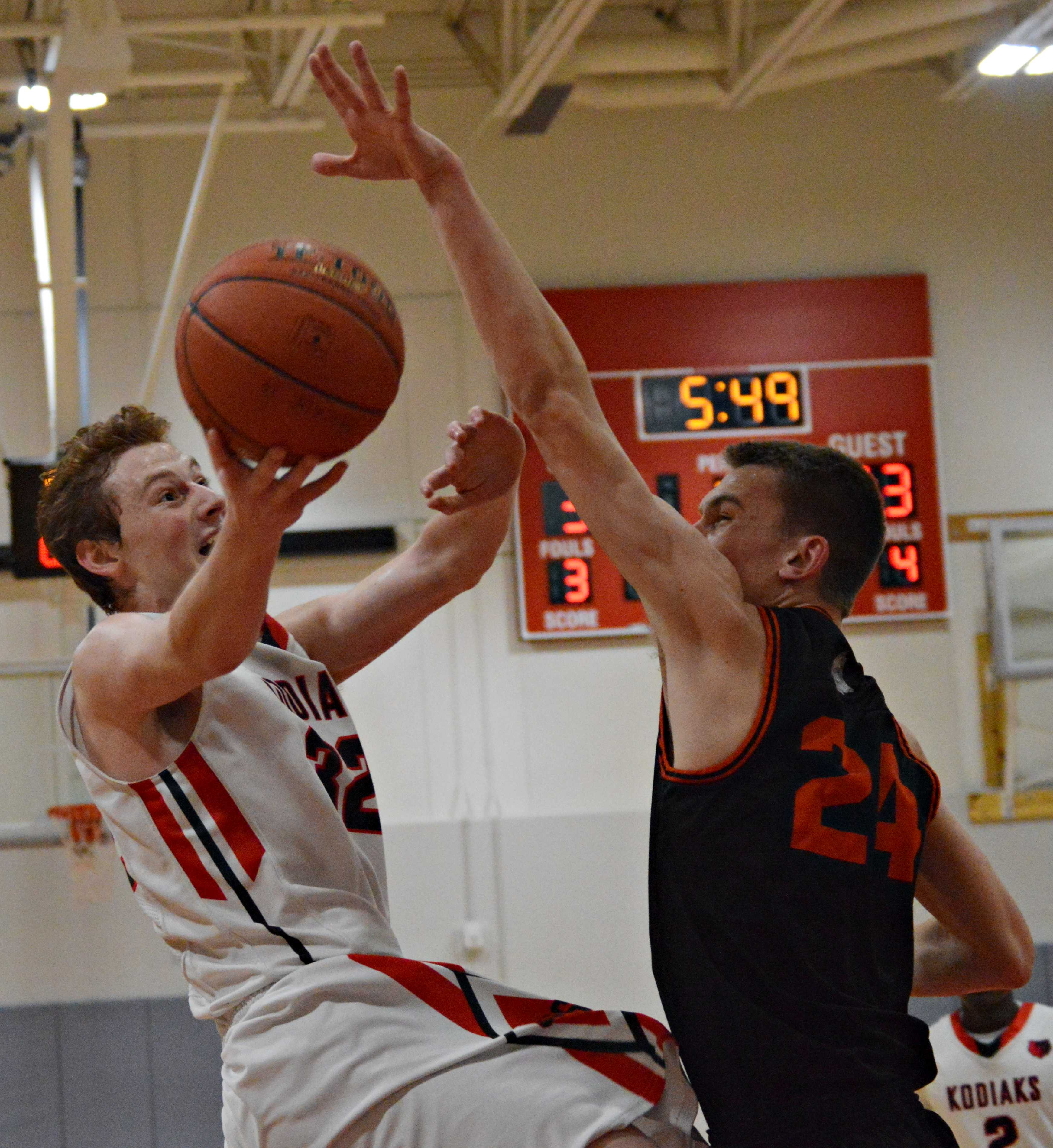 Cascade's Hans Schlyer attempts a layup with a Cashmere defender in his way