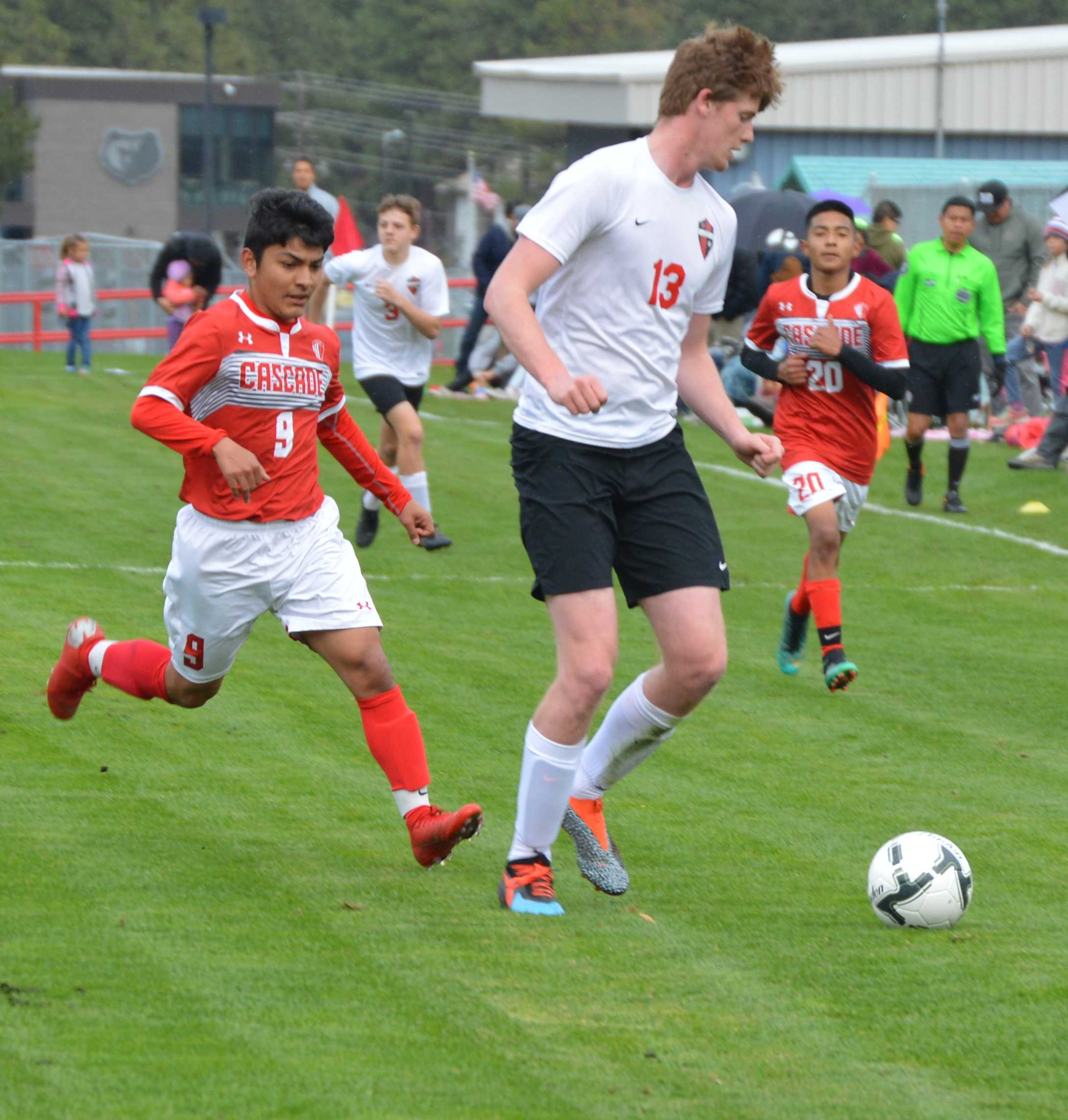 Cascade's Arturo Avila chases down an Omak defender. Avila had two goals during Cascade's match with Omak.