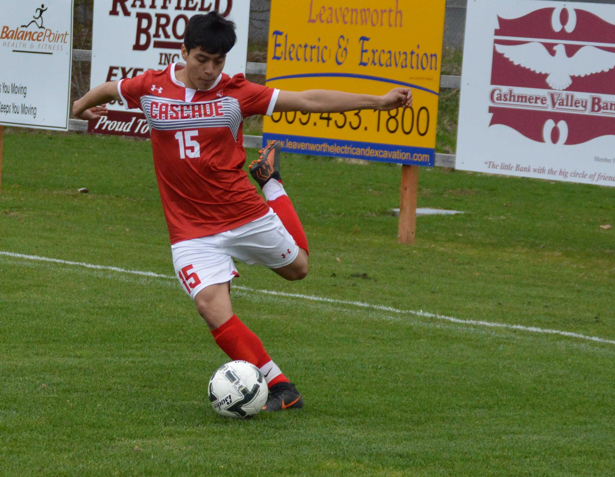 Cascade's Victor Oropeza kicks the ball to an open teammate.