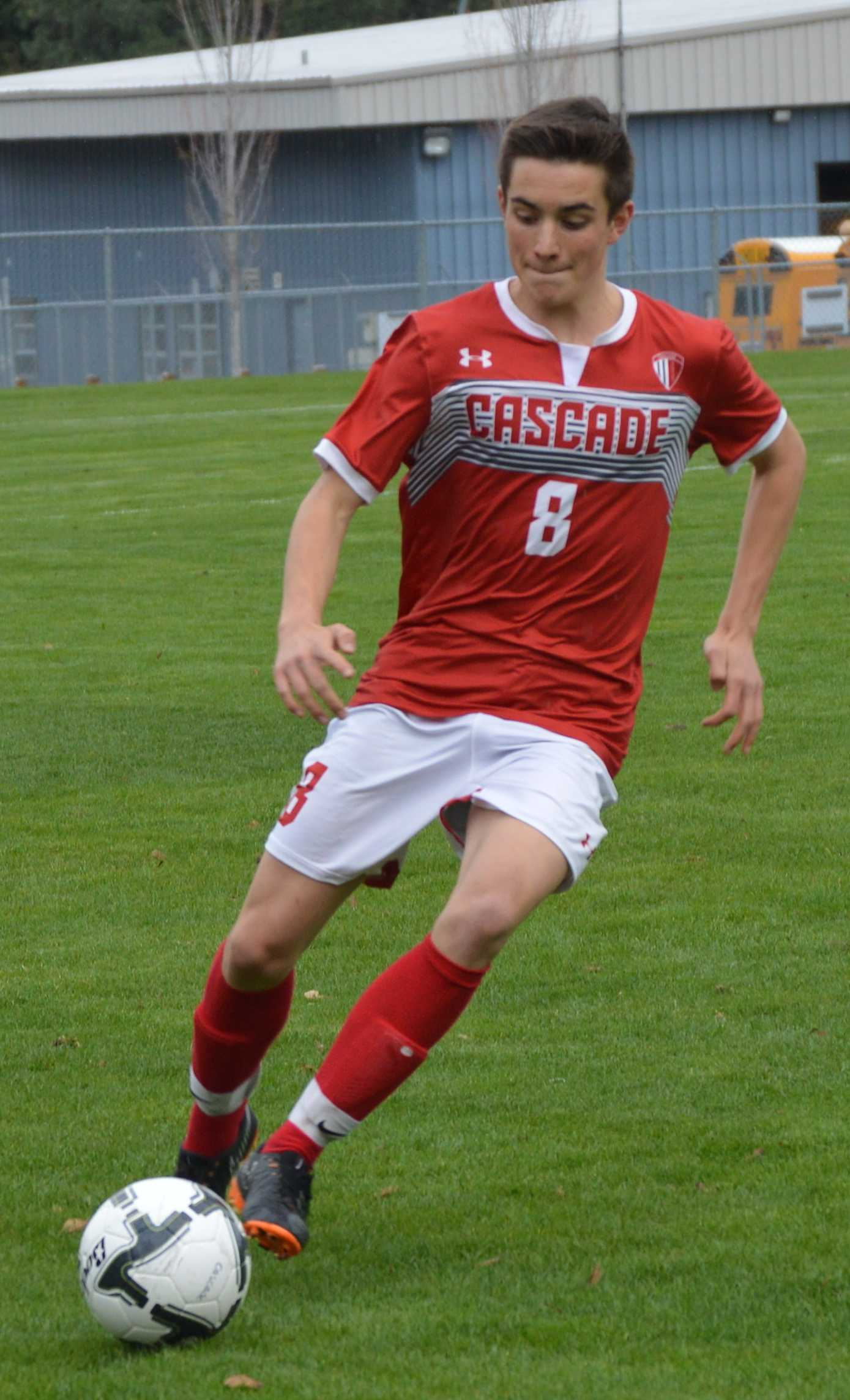 Cascade's Will Piers gets a foot on the ball.