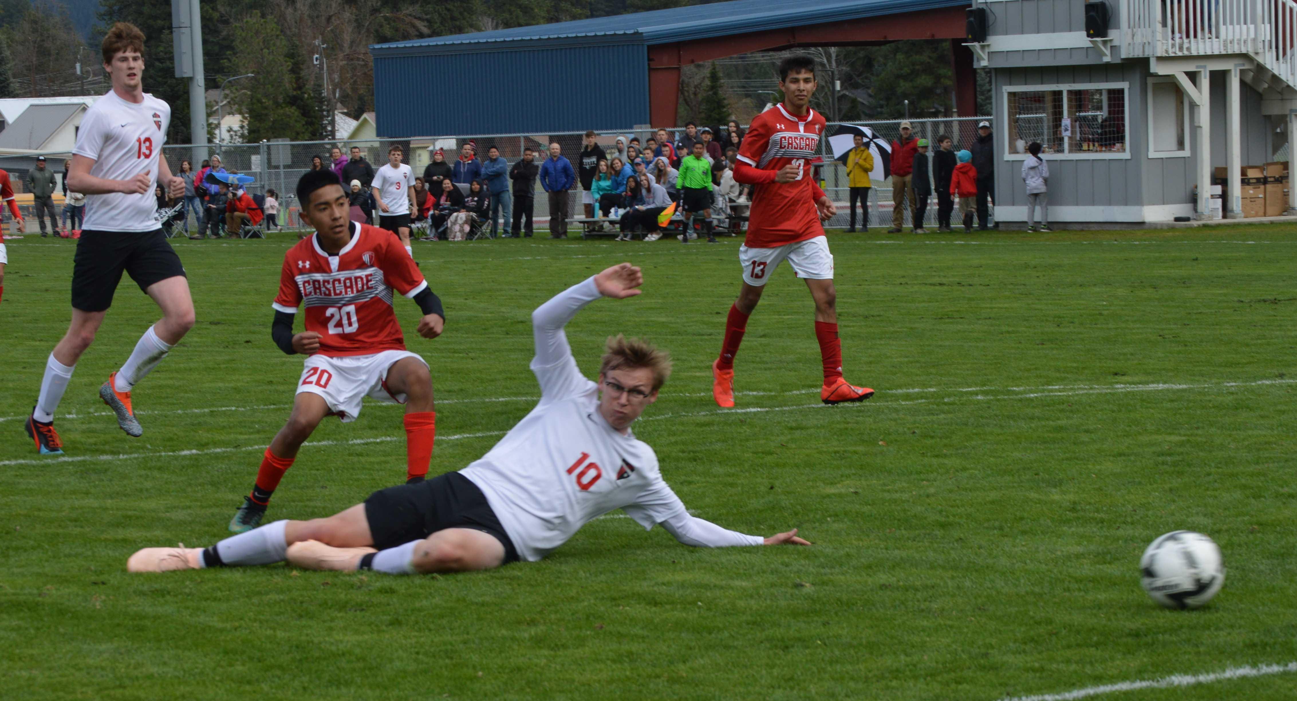 Arturo Avila watches the ball slide past an Omak defender.