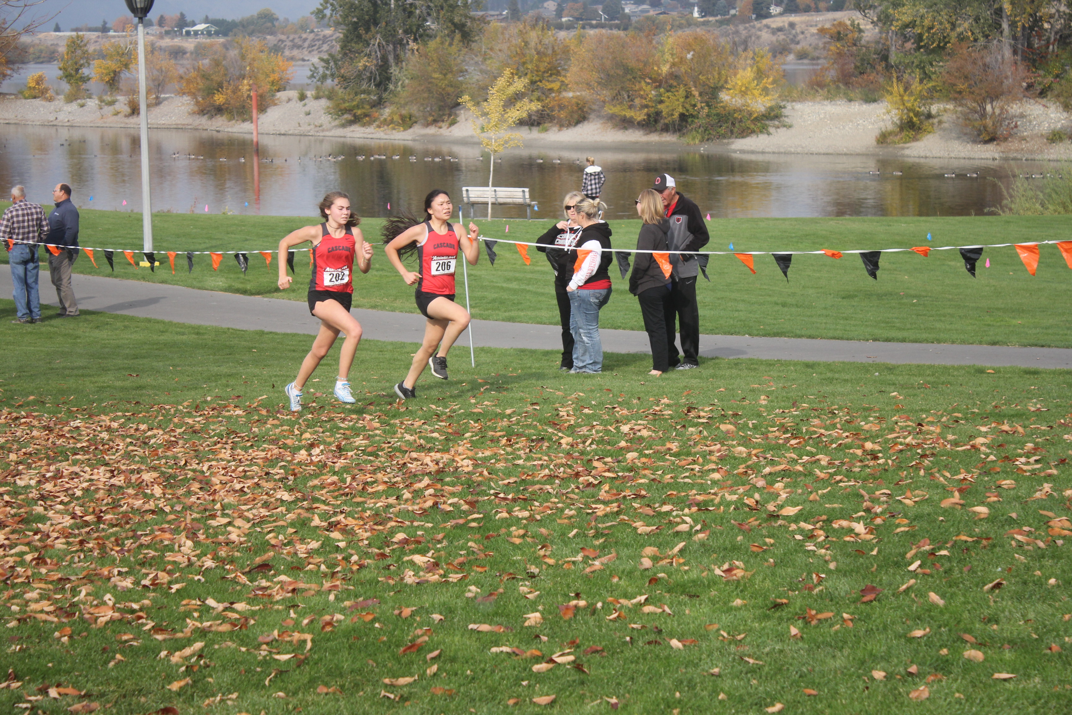 Tiera Groff and Isabel Rodriguez stride side by side.