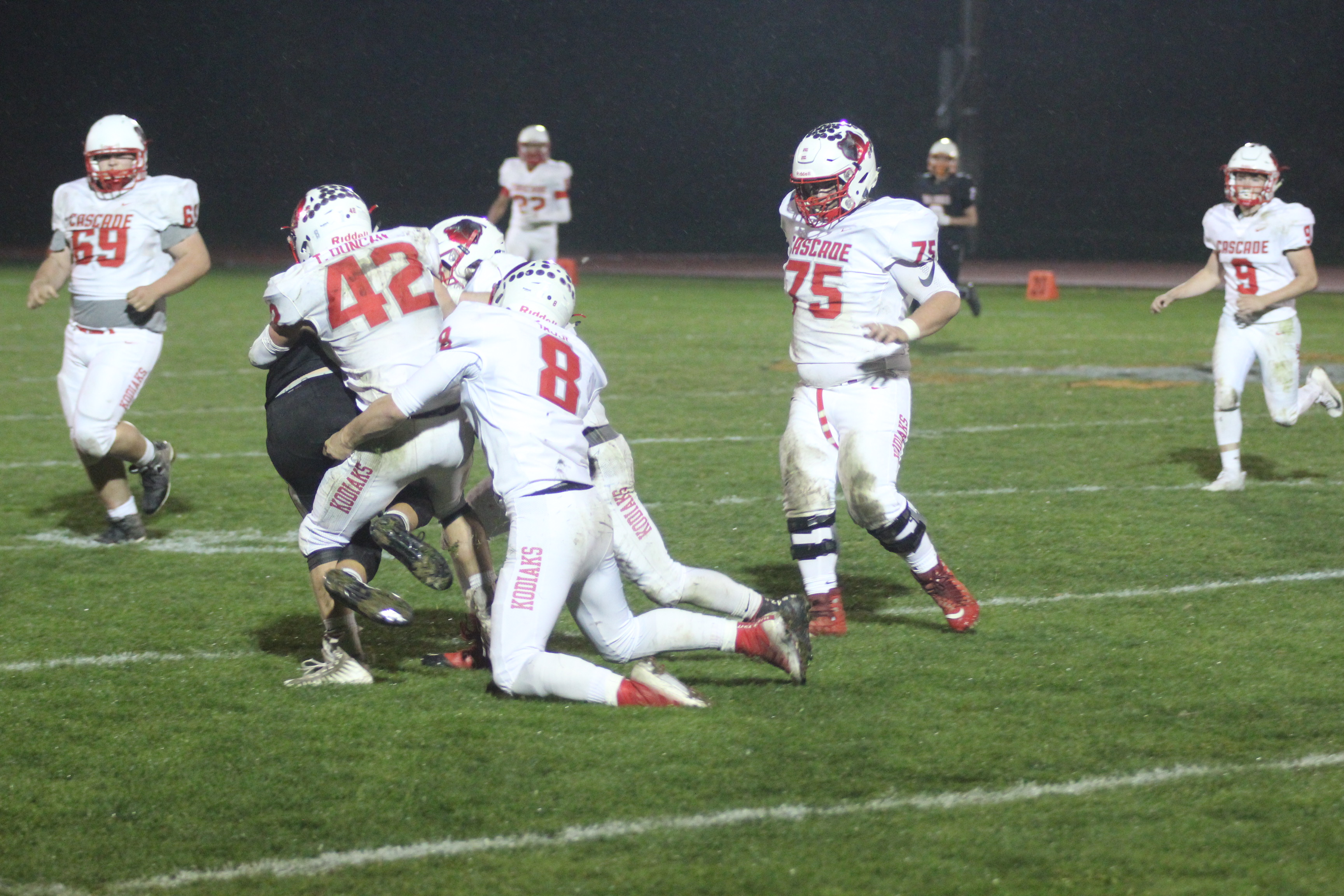 Cascade Kodiaks' tackle the Cashmere Bulldog in possesion of the ball