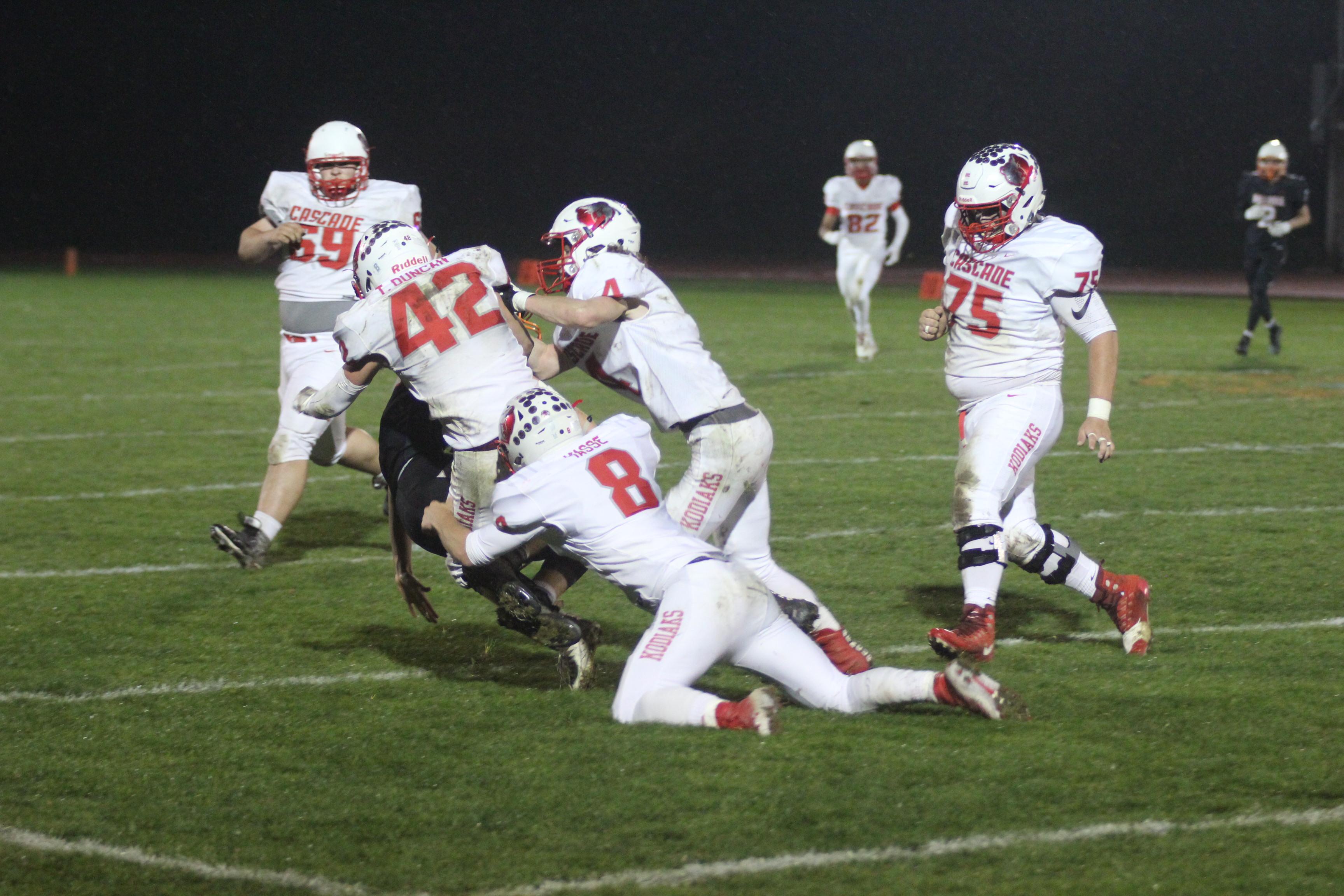 Kodiaks tackle in a group effort.
